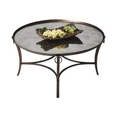 Butler Specialty 1289025 Metalworks Cocktail Table This Table by Butler Specialty has an antique copper finish.  Metalworks Cocktail TableSubtle elegance