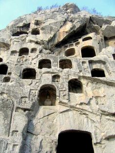 "China - The Longmen Grottoes or Longmen Caves are one of the finest examples of Chinese Buddhist art. There are as many as 100,000 statues within the 1,400 caves, ranging from an 1 inch (25 mm) to 57 feet (17 m) in height. The area also contains nearly 2,500 stelae and inscriptions, whence the name ""Forest of Ancient Stelae, as well as over sixty Buddhist pagodas. #RTW #travel www.goachi.com"