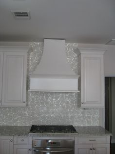 mother of pearl oyster white glass tile - kitchen backsplash idea.