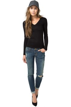 Take a cue from the boys and rock these comfy boyfriend jeans with long sleeve tee and slip-ons! Destroyed, light washed finish. Five pocket styling. Belt loops at the waist. Zip fly. Button front closure. Cuffed leg openings. Contrast topstitching. $36.50