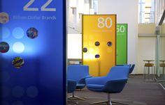 colored panel dividers | Atrium graphic monuments #office #corporate #design