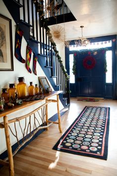 Gorgeous entrance by Tess Fine with colonial blue paint and trim, love the stockings and rug too!