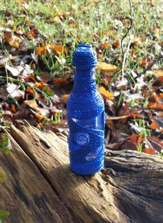Blue bottle from glass and polymerclay
