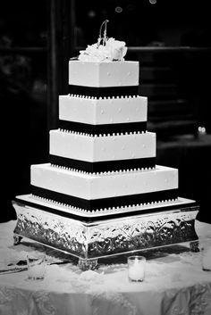 black and white wedding cake.. I'd do crimson roses on top though.