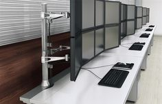 This modern workspace features adjustable ergonomic monitor arms and computer accessories for a high tech feel. All of the products shown are available at OfficeFurnitureDeals.com with free nationwide delivery. #ErgonomicAccessories #ErgonomicProducts #OfficeProducts - http://www.officefurnituredeals.com/Office-Accessories-s/520.htm