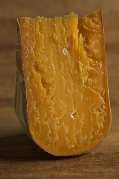 """Beemster X-O Matured for 26 months, Beemster X-O- has a deep amber-colored paste and a firm, slightly flaky texture with occasional """"eyes"""" or holes. Flavors are of butterscotch and grass with notes of whisky and almonds."""
