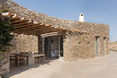 The walls of the two-bedroom house are designed to look like the stone retaining walls that are typical of Greek landscapes. Known locally as xerolithies, these low walls were traditionally used in the cultivation of land. Vernacular Architecture, Landscape Architecture, Architecture Design, Pocket Park, Rural House, Interior Desing, Space Gallery, Wooden Pergola, Urban Furniture