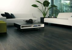 Magnitude Blackfired Oak is a Rich Black Oak Effect Laminate Floor. The matt-shiny laminate from the Magnitude collection not only looks like a real oak plank floor, it feels like one too. Dark Laminate Wood Flooring, Hardwood Floors, Couch, Room, Furniture, Design, Home Decor, Chrome, Wood Laminate Flooring