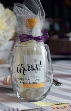 Personalized wine glasses with a minature bottle of wine inside! And instead of table numbers, each table was named for a different type of wine at Mary and Anthony's wedding, August 2015. @VinoPlease #VinoPlease