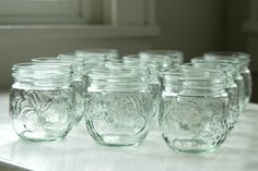 12 Small Glass Jelly Jars . for Canning . or Country Wedding decor. $10.00, via Etsy.