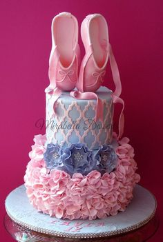 Ballet Inspired Cake by Mirabella's Desserts - Moroccan Lattice from Marvelous Molds was used to make the top tier. The ruffled bottom tier was created using a 6-petal blossom cutter to give a tutu-inspired look. The ballet slippers were created using a tutorial by Peggy Does Cake.