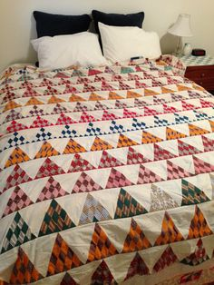 """1800s Quilt Top   eBay seller sewhen; pieced quilt top in fair condition.  If I keep this quilt, I'd take the blocks and reset them because most of the stains are in the setting blocks.  I washed this but could  [not] release those spots :(  There are a couple of blocks that have shattered, most in great shape, shown on a double bed; quilt measures 80"""" x 86""""."""