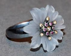 """Cameli"" Silver ring with flower of quartz, in the centre of flower there are rocks - amethysts, yellow garnet and diamond 192$"
