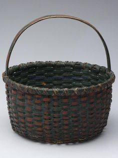 SHENANDOAH VALLEY OF VA PAINTED WHITE OAK SPLINT BASKET, circular with x wrap rim, arched handle, kick up bottom, original green and red painted surface, possibly by a member of the Nichols family of basketmakers from Page County, VA, first quarter 20th century