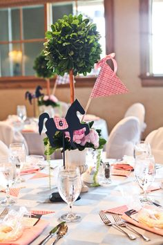 "Kentucky Derby Bridal Shower #topiary Centerpieces. Each horse/table number had a different pink and blue patterned ""silk"" with matching pennant flags at each place setting. #pink #navy #preppy #KentuckyDerby #BridalShower"