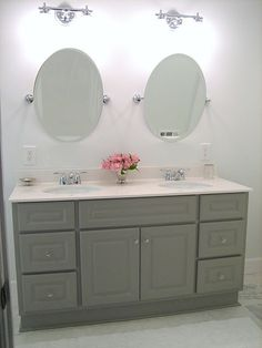 "Vanity painted in Martha Stewart Cement Gray, Vintage glass knobs from Home Depot, ""Banbury"" by Moen fixtures from Home Depot"