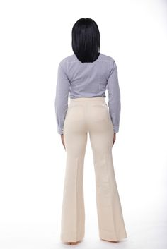 This high-waist wide-leg flare silhouette pants with concealed middle zipper fastener and one button closure, is tailored to offer the perfect feminine fit and glamorous look. Its flat front builds and elongated inseams helps to further the of its vintage silhouette. Pair with a button up for the perfect office look, and release a few buttons for a teasing date night look!