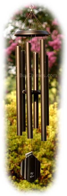 Wind chimes! Not necessarily exactly like this. Plays sweet tones and moves readily in the breeze...something that does that.