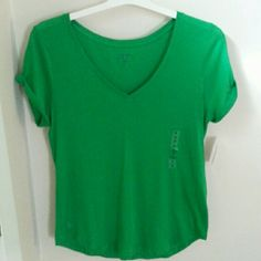 NWT- POLO  RALPH LAUREN  TOP-Price Firm Polo Ralph Lauren Beautiful Vivid Green Top. Logo on Front Bottom Right.  Made in Peru. 100% cotton. These tops are so comfy and look great! Polo by Ralph Lauren Tops Tees - Short Sleeve