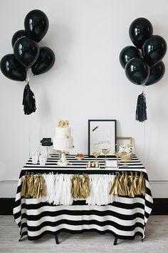 black, white, and gold dessert table