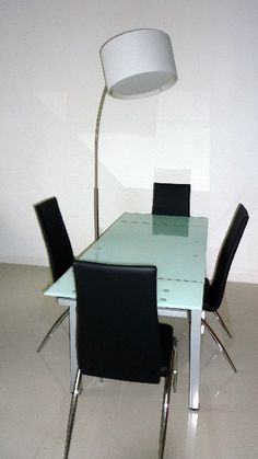 """With 20' ceilings, hanging a chandelier is out of the question. The solution to illuminate the table is an arc lamp. The lamp can easily rotate to shed light on the conversation area after dinner. The dining table is tempered glass and extends from 43"""" to 66"""" to easily accommodate 6. Frosted Glass, Clear Glass, Dining Area, Dining Table, Conversation Area, Arc Lamp, Interior Design Photos, One Bedroom Apartment, Rental Property"""