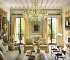 Pale green and creamy yellow living room / library -- Architect: William Hablinski Architect -- Designer: Atelier AM -- Photographer: Pieter Estersohn -- Architectural Digest, September 2012