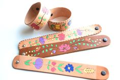 folk art burnt leather cuffs