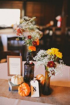 Add pumpkins to reception tables for simple, striking centerpieces / http://www.himisspuff.com/fall-wedding-ideas-themes/