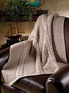 Timeless style captured in an elegant and sophisticated throw. If you'd like to give a gift throw of heirloom quality, this is an outstanding choice! Choose a color to please the recipient or make it in a timeless neutral shade. Knit with approxima...
