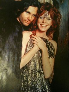 Jim Morrison & Pamela Courson @ Pam's boutique Themis. Jim provided the funds so she could open her dream store. This is from the grand opening photo shoot.