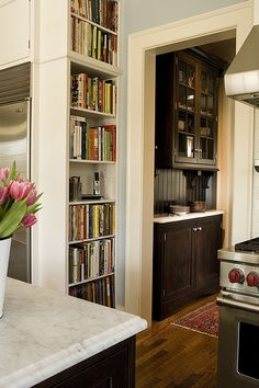 A built in bookshelf houses all the cookbooks and creates a convenient nook for the house phone to be nearby but out of the decorating before and after interior design room design Kitchen Redo, Kitchen Remodel, Kitchen Pantry, Kitchen Bookshelf, Kitchen Designs, Kitchen Ideas, Pantry Cabinets, Kitchen Renovations, Built Ins