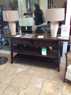 Console table. Could do baskets on shelves for storage. Sprintz