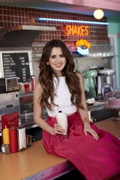 01f09369b610 We re head over heels for Laura Marano s white and hot pink color-blocked  prom dress from her Sherri Hill line!