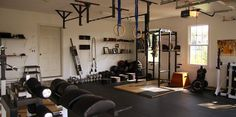 This strongman garage gym is 100% fitness. all kinds of major equipment in here. jealous