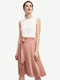 """Topped with a stylish sash, our finely pleated skirt boasts a little swish, a bit of leg and endless ways to wear. Pair with strappy sandals for added kick. Detachable self-tie belt. Belt loops. Hidden side zipper with hook-and-eye closure. Lined. 26"""" skirt length; 20"""" lining length."""