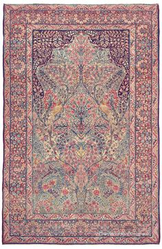 Antique Persian Rug, Laver Kirman Tree of Life, circa 1900. This striking antique rug exudes a romantic atmosphere through its great fluidity and lyricism of design, with two charming doves nestled on the tree's branches.