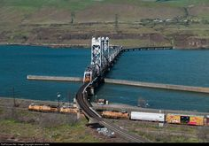 While a Union Pacific manifest rolls by underneath, a BNSF grain peeks out of the Oregon Trunk's Columbia River crossing.Net Photo: BNSF 3848 BNSF Railway GE at Celilo, Oregon by Jeremiah Lietke California Zephyr, Bnsf Railway, Union Pacific Railroad, Burlington Northern, Columbia River, Cityscapes, Train Station, Model Trains, Caves