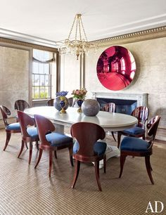 An artwork by Anish Kapoor surmounts the fireplace in a New York dining room by Stephen Sills.