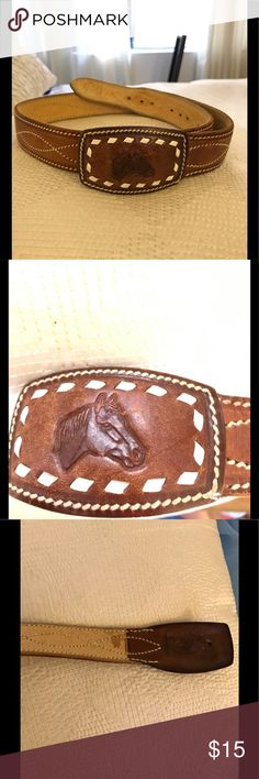 """Authentic 1955 vintage leather Western Belt Brown Leather Belt with white stitch work. Embossed horse head on buckle. Inside of buckle is stamped with date made (1955) and place (Costa Rica). Perfect for a rockabilly. Gentle signs of wear. Great vintage piece. 37"""" long with adjustable Belt holes . Smoke free home. 1955 Vintage Accessories Belts"""