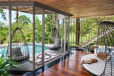 The bedrooms at Thailand's Keemala Phuket Resort features views over the treetops of Keemala. See more of this incredible Southeast Asian hotel now.