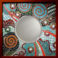 Galaxy Mosaic Mirror with rich aqua and red glass in a swirling glass pattern