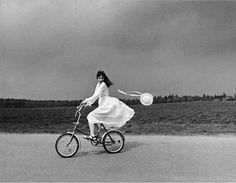 by Antanas Sutkus  Girl on a bike. Lithuania