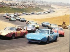 40 Awesome Images From The Glory Days Of Racing Photos from the glory days of NASCAR, vintage racing images & classic muscle car photos. Photos of Richard Petty, Dale Earnhardt, Cale Yarborough & more! Nascar Autos, Nascar Race Cars, Old Race Cars, Us Cars, Muscle Cars Vintage, Vintage Race Car, Carros Nascar, Supercars, Exotic Sports Cars
