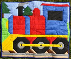 Train Quilt pattern with Multiple sizes - this is the pattern I used for my nephew's quilt.  She has some pretty cool stuff on her etsy site