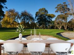 A wall mural of Rossdale Golf Course in Melbourne - these bright colours create a refreshing scene in this dining room!