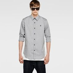 Slim long sleeve shirt with a button-up placket and rounded hem.