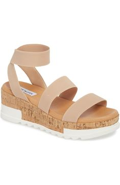 Cork texturing and razor lugs add mixed-media appeal to this strappy wedge sandal. 1 platform (size 3 strap height Slip-on style with elastic ankle strap Textile upper/synthetic lining and sole Imported Zapatos Steve Madden, Steve Madden Shoes, Chambray Shirt Outfits, Sandals Outfit, Strappy Wedges, Style Casual, Platform Wedge Sandals, Trendy Shoes, Trendy Sandals