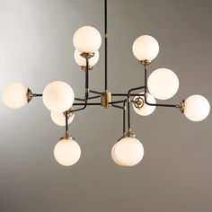 """This chandelier is incredibly stylish and architecturally inspired. Its airy frame maintains a refined look while the 12 globe-style lights provide ample lighting. Choose from Antique Brass with White glass or Polished Nickel with Clear glass.12x40 watts candle base lamps max.(29""""Hx47""""W)OAH 60"""", supplied with 1x6"""" , 1x12"""" and 1x18: stem and 4.5"""" round canopy."""