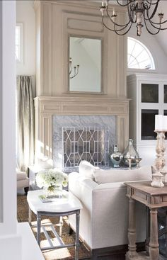 This Ivy House : Photo - gorgeous pale living room with a really pretty fireplace mantel and I adore the white chippendale fire screen