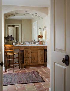 Terracotta floor, rustic vanity and lavender growing in the bathroom. Perfect!